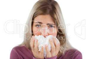 Blonde woman using handkerchief