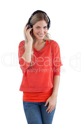 Smiling woman enjoying music