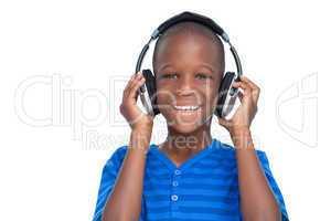 Happy little boy listening to music