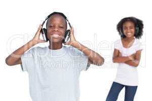 Brother and sister using headphones