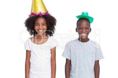 Kids wearing party hats