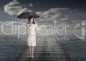 Elegant businesswoman holding an umbrella
