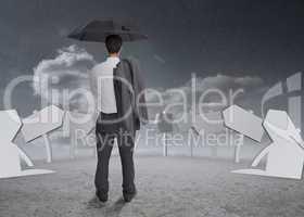 Thinking businessman holding his umbrella and jacket