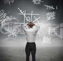 Anxious businessman losing at noughts and crosses