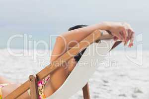Woman resting on her deck chair