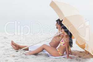 Couple lying on beach towel at the beach