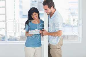 Woman opening boyfriends gift