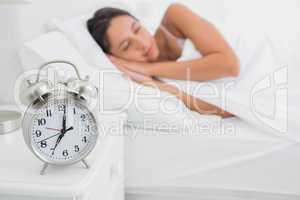 Woman sleeping deeply in bed