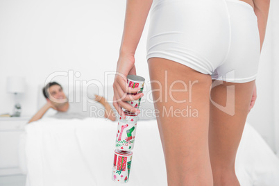 Sexy woman bringing christmas cracker to her partner