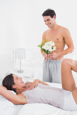 Handsome man offering flowers
