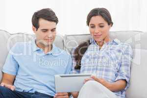 Couple relaxing with a tablet