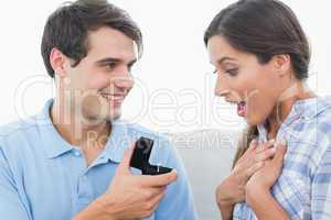 Man offering an engagement ring to his girlfriend