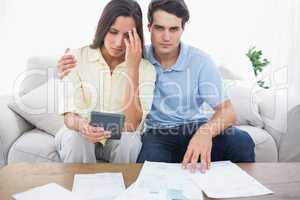 Anxious couple doing their accounts
