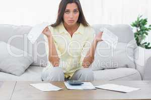 Concerned woman doing her accounts
