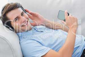 Portrait of a man enjoying music with his smartphone
