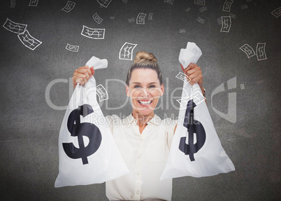 Businesswoman holding cash bags