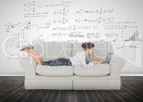 Elegant businesswoman lying on a couch