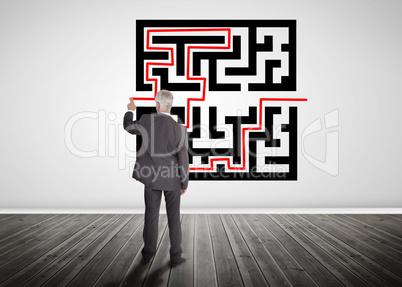 Businessman drawing line through quick response code