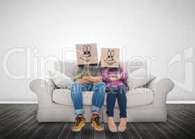 Couple wearing funny boxes on their head