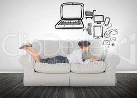 Businesswoman lying on a sofa