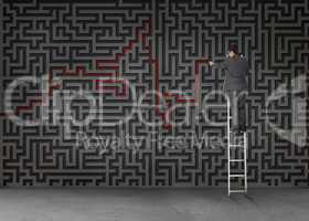 Businessman standing on a ladder and drawing a red line through