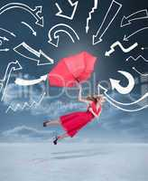 Glamour woman flying with an umbrella