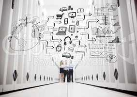Colleagues in a data center standing in front of a drawing