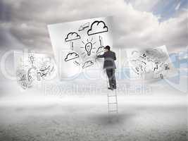Businessman on a ladder drawing a process