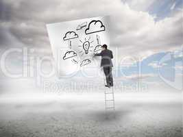 Businessman standing on a ladder drawing a process