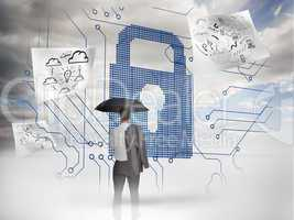 Businessman under an umbrella looking at a giant padlock