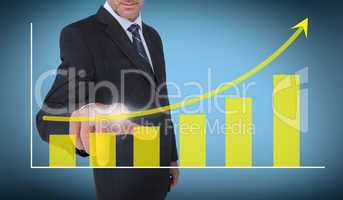 Businessman selecting a growing chart