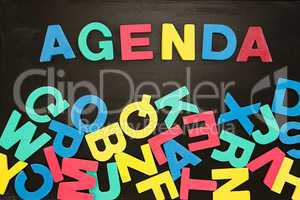 The word agenda written with colored letters