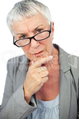 Thinking mature woman wearing glasses