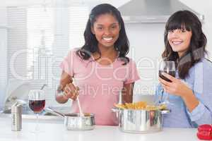 Happy friends preparing dinner together