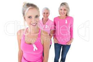 Three generations of women wearing pink tops and breast cancer r