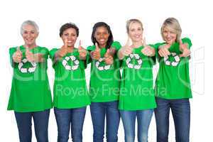 Team of female environmental activists giving thumbs up