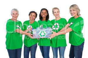 Team of happy female environmental activists holding box of recy