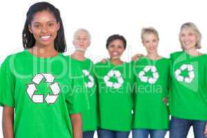 Team of female environmental activists smiling at camera