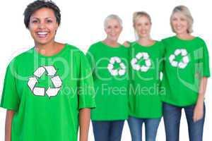 Happy women wearing green recycling tshirts