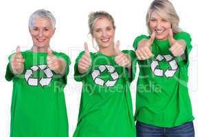 Three women wearing green recycling tshirts giving thumbs up