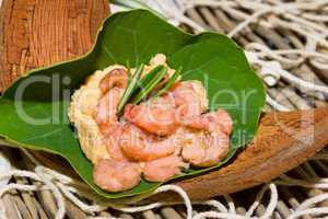 Portion of shrimps on a nasturtium leaf