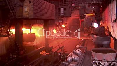 Iron and Steel Works. Converter plant. Loading scrap metal into a melting furnace.