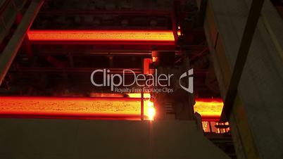 Hot rolled steel. Cutting a slab of hot metal.