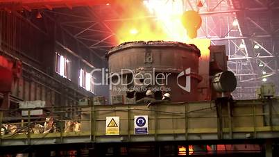 Iron and Steel Works.A huge bucket (barrel) with the molten iron.