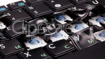 Laptop keyboard with distorted keys