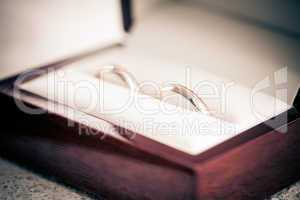 two wedding rings in a box