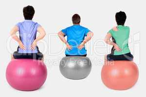 Women and man with exercise ball