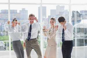 Group of business people raising arms as a success