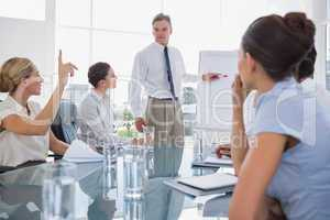 Businesswoman asking something during a meeting