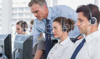 Manager helping call centre agent